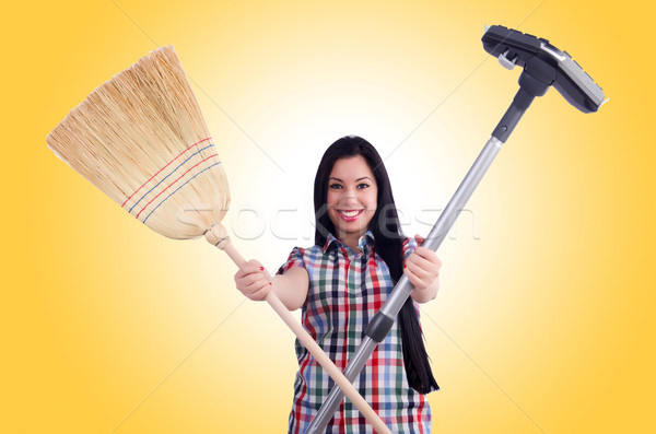 Young housewife doing housekeeping on white Stock photo © Elnur