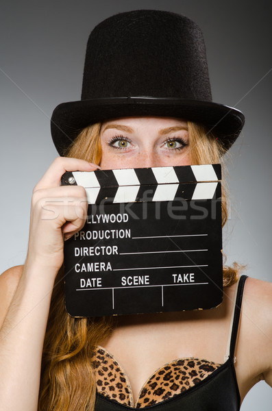 Woman with movie board wearing hat Stock photo © Elnur