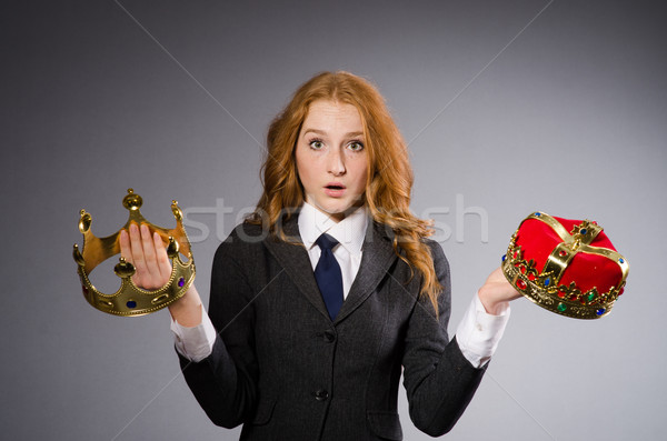Woman with crowns against background Stock photo © Elnur