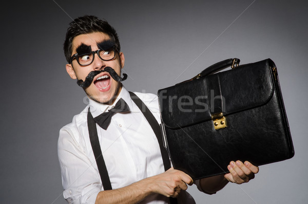 Young man with false moustache isolated on gray Stock photo © Elnur