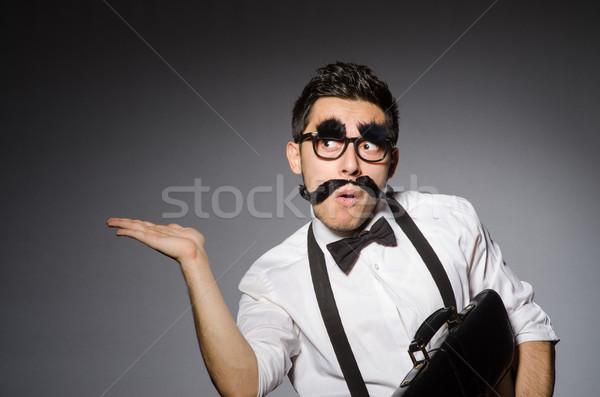Młody człowiek fałszywy wąsy odizolowany szary człowiek Zdjęcia stock © Elnur