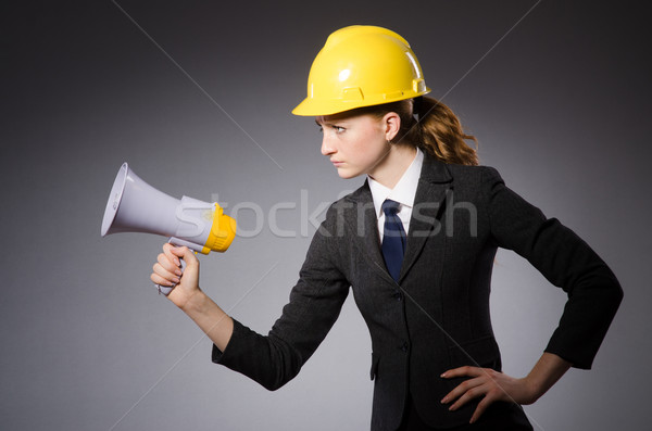 Femenino ingeniero casco altavoz aislado gris Foto stock © Elnur