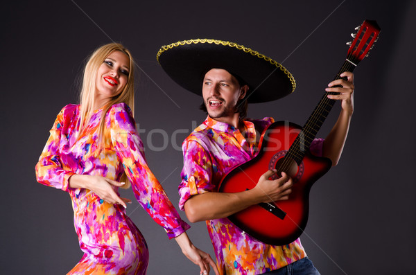 Spanish pair playing guitar and dancing Stock photo © Elnur