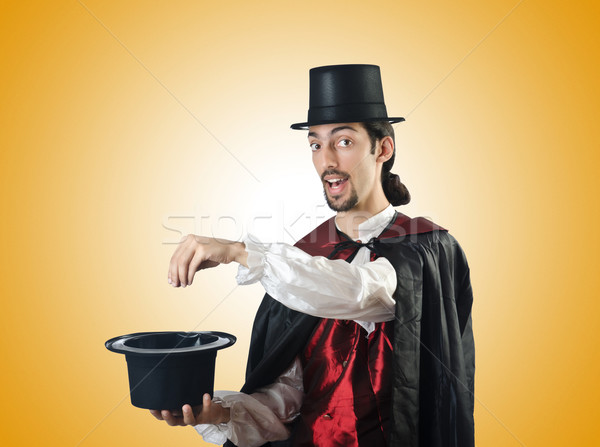 Magician doing tricks on white Stock photo © Elnur