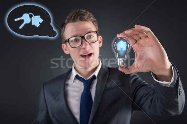 Fiatalember jelzálog villanykörte üzlet pénz épület Stock fotó © Elnur
