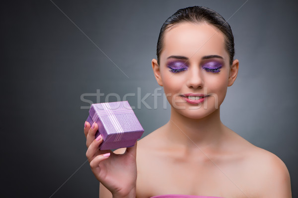 Young woman receiving small giftbox Stock photo © Elnur
