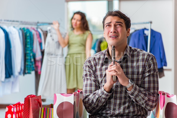 The man fed up with wife shopping in shop Stock photo © Elnur