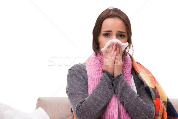 Sick woman lying on the sofa Stock photo © Elnur