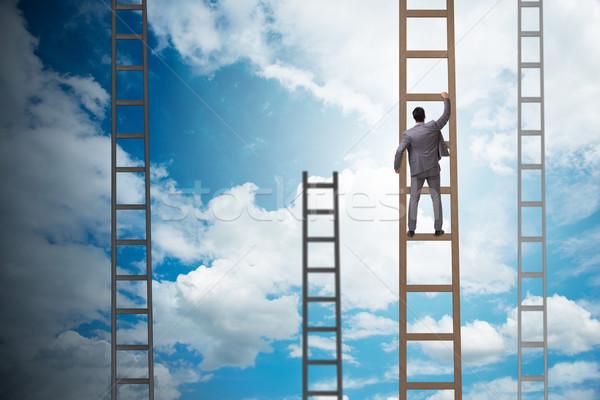 молодые бизнесмен скалолазания карьеру лестнице облака Сток-фото © Elnur