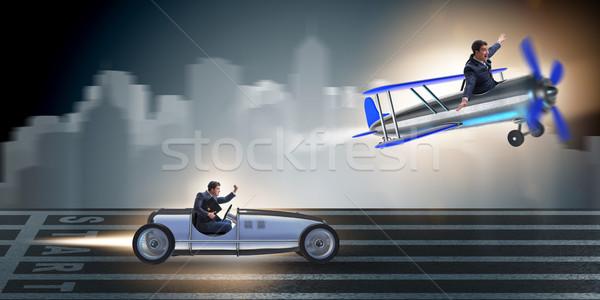 Businessman racing on car and airplane Stock photo © Elnur