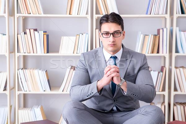 üzletember diák lótusz pozició könyv férfi Stock fotó © Elnur