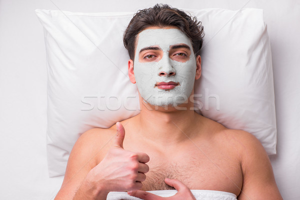 Handsome man in spa massage concept Stock photo © Elnur