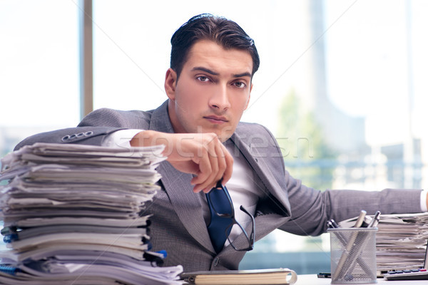 Busy angry businessman with heaps of paper Stock photo © Elnur