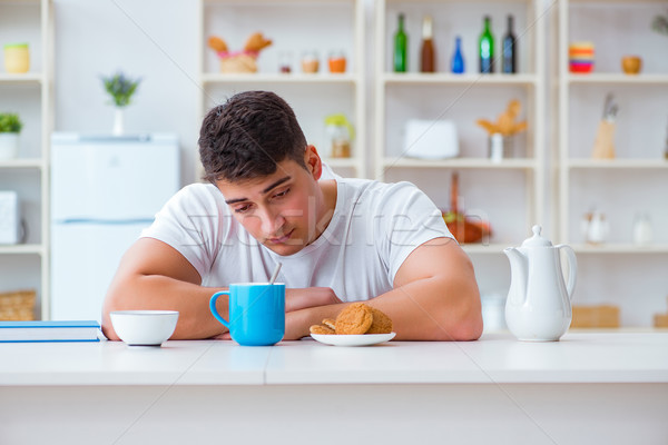 The man falling asleep during his breakfast after overtime work Stock photo © Elnur
