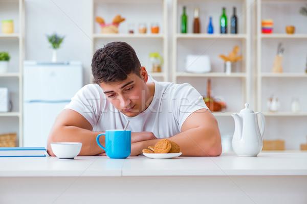 Adam düşen kahvaltı fazla mesai çalışmak Stok fotoğraf © Elnur