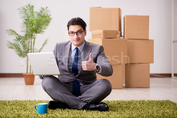 Businessman sitting on the carpet in office Stock photo © Elnur