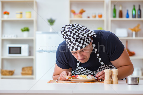 Chef cook cooking a meal breakfast dinner in the kitchen Stock photo © Elnur