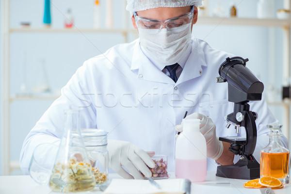 化学者 ラボ 油 ボトル 女性 液体 ストックフォト © Elnur