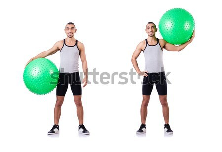 Man with swiss ball doing exercises on white Stock photo © Elnur
