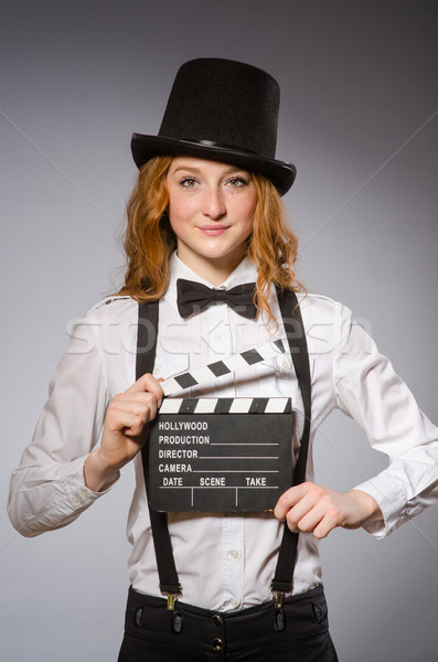 Young woman with movie board   Stock photo © Elnur