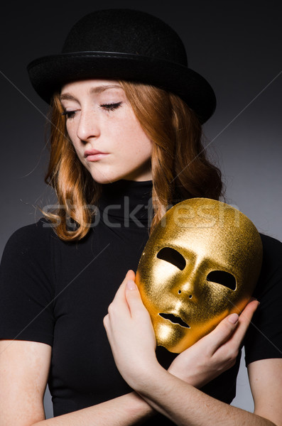 Redhead woman in hat  iwith mask in hypocrisy consept against da Stock photo © Elnur