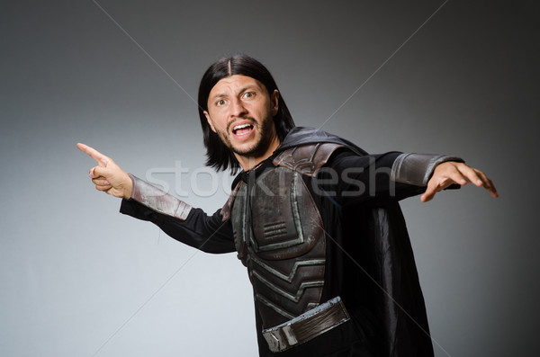 Stock photo: Funny knight against dark background