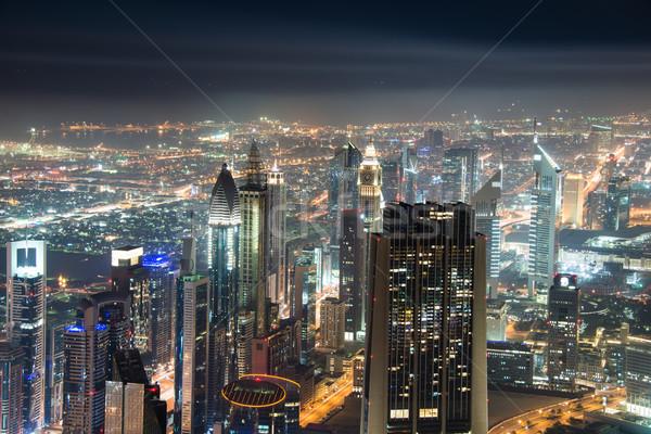 Noite Dubai pôr do sol céu água edifício Foto stock © Elnur