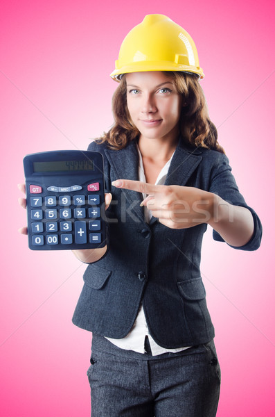 Female builder with calculator against the gradient Stock photo © Elnur