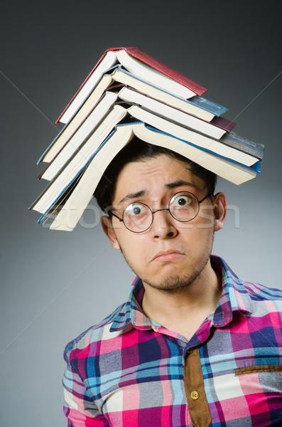 Divertente studente molti libri uomo sfondo Foto d'archivio © Elnur
