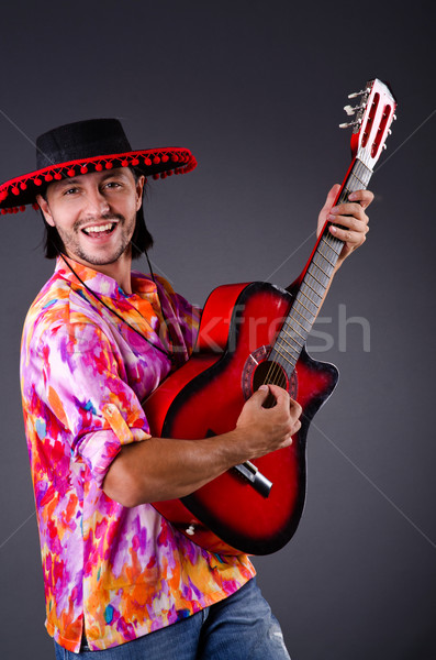 Man wearing sombrero with guitar Stock photo © Elnur