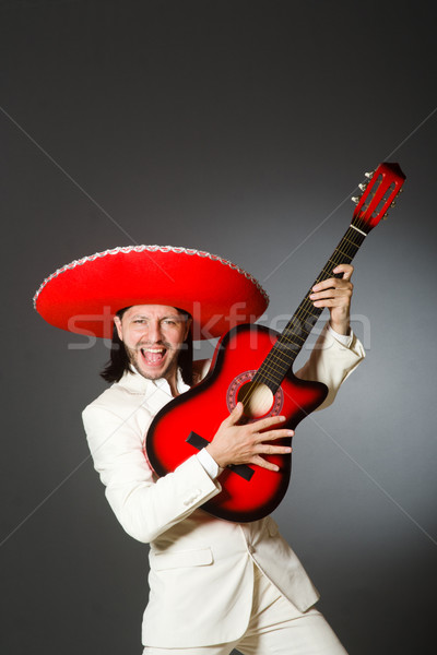 Young mexican guitar player wearing sombrero Stock photo © Elnur