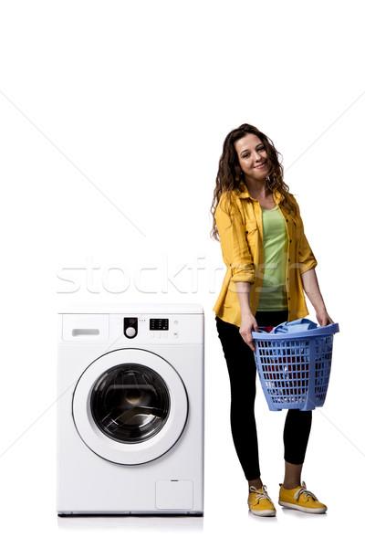 Młoda kobieta brudne pranie odizolowany biały kobieta Zdjęcia stock © Elnur