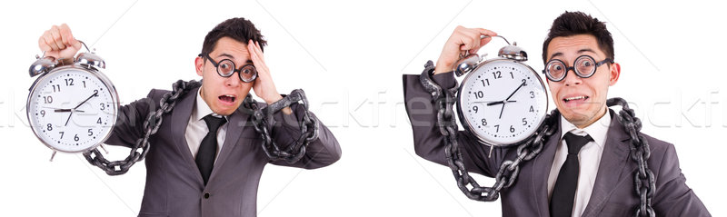 The businessman holding alarm clock isolated on white Stock photo © Elnur