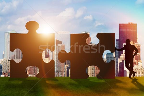 üzlet csapatmunka kirakós játék épület férfi absztrakt Stock fotó © Elnur