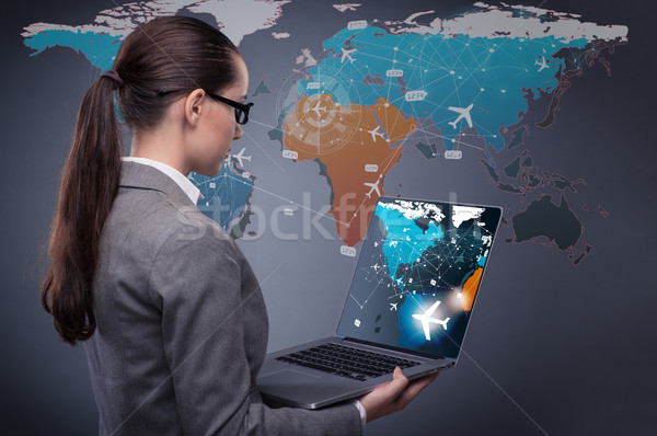 Concept of online booking with busineswoman and laptop Stock photo © Elnur