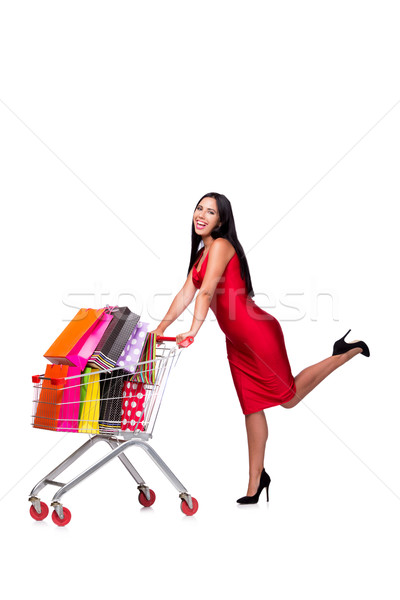 Woman in red dress after shopping isolated on white Stock photo © Elnur