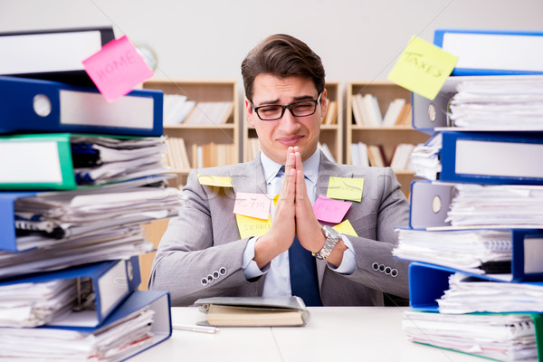 Businessman struggling with multiple priorities Stock photo © Elnur