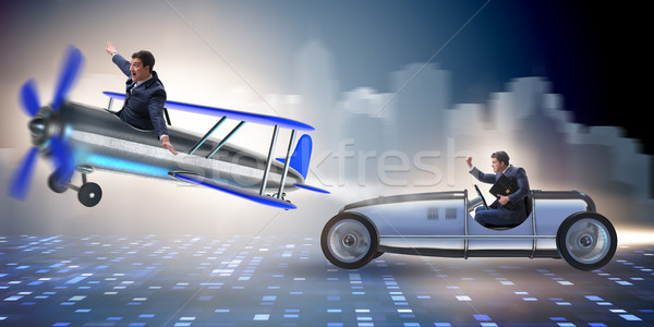 The businessman racing on car and airplane Stock photo © Elnur