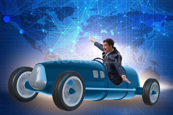 Businessman riding vintage roadster in motivation concept Stock photo © Elnur