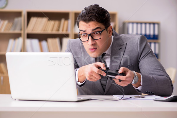 Businessman playing computer games at work office Stock photo © Elnur