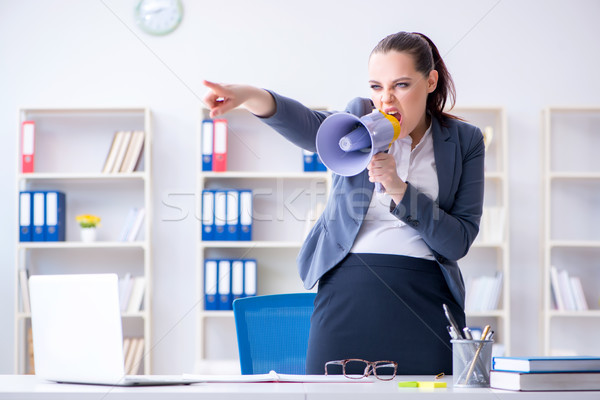 Angry businesswoman yelling with loudspeaker in office Stock photo © Elnur