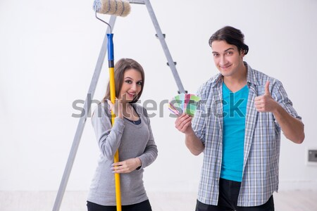 Young family painting the walls in DIY concept Stock photo © Elnur