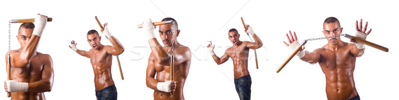Martial arts warrior with nunchucks on white Stock photo © Elnur