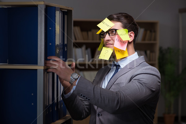 Businessman struggling with conflicting priorities during long h Stock photo © Elnur