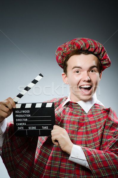 Funny scotsman with movie clapboard Stock photo © Elnur