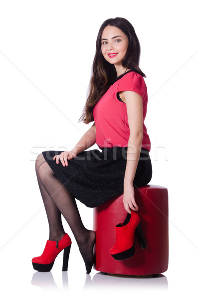 Woman trying new shoes isolated on the white Stock photo © Elnur