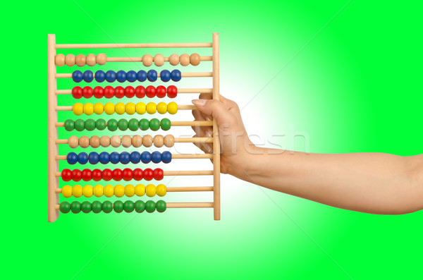 Hand holding abacus on white Stock photo © Elnur