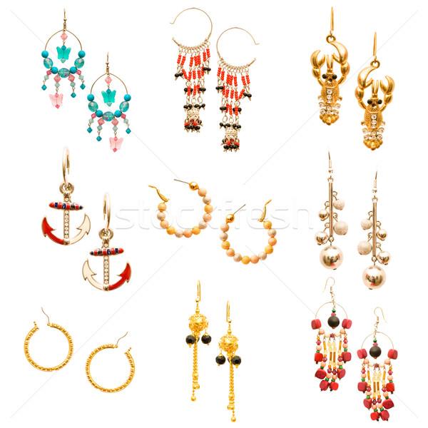 Set of various earrings isolated on white Stock photo © Elnur