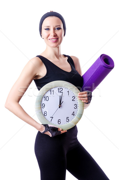 Female sportsman holding rug and clock isolated on white Stock photo © Elnur