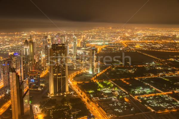 Stock fotó: Panoráma · éjszaka · Dubai · naplemente · égbolt · víz